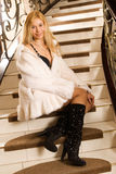 Sexy young blond in fur coat Royalty Free Stock Photos