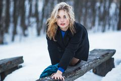 young blond girl in snow in winter nature royalty free stock photo