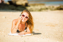 Sexy young blond girl in sunglasses speaking on Stock Image