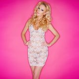 Sexy young blond in a see-through dress Stock Photos