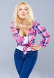 Sexy young blond woman blowing a kiss Royalty Free Stock Photography