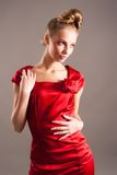 Sexy young blond woman in red Royalty Free Stock Images