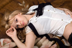 Sexy young blonde. Beautiful sexy young blonde lying on blanket Royalty Free Stock Image