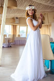 Sexy young blonde bride in a cruise wedding white dress in a summer sea restaurant. Fashion beauty portrait Stock Images