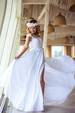 Sexy young blonde bride in a cruise wedding white dress in a summer sea restaurant. Fashion beauty portrait Royalty Free Stock Images