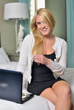 Sexy young blonde business woman in bedroom Stock Images