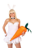 Sexy young blonde with a carrot Royalty Free Stock Photo