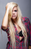 young blonde female against grey Royalty Free Stock Photos