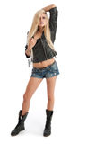 Sexy young blonde female in shorts and leather jac Royalty Free Stock Photos