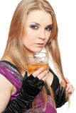 young blonde with a glass of whiskey royalty free stock photography