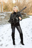 Sexy young blonde with a gun Royalty Free Stock Photos