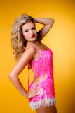 Sexy young blonde in a pink dress Stock Photography