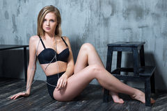 Sexy young blonde woman in black luxury lingerie Royalty Free Stock Photos