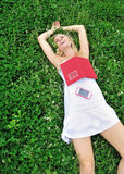 Sexy young blonde woman laughing in the grass Royalty Free Stock Photography