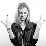 Sexy young blonde woman in leather jacket posing. Black and white portrait of sexi young blonde lady in leather jacket posing happy smiling over light copy space Royalty Free Stock Images