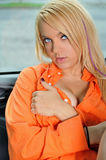 Sexy young blonde woman in orange shirt Stock Photography