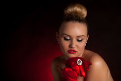 Sexy young blonde woman in red gloves and a big ring Royalty Free Stock Photo