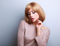 Sexy young blonde woman with short hair style posing Royalty Free Stock Photography