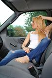 Sexy young blonde woman in truck Stock Images