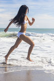 Sexy Woman Girl in Bikini Running on Beach Royalty Free Stock Image