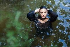young brunette beauty in a water Royalty Free Stock Photography