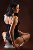 Sexy young brunette in black corset Royalty Free Stock Photos
