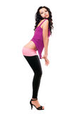 Sexy young brunette in a black leggings. Isolated Royalty Free Stock Images