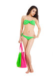 Sexy young  brunette girl wearing green swimsuit holding pink ba Royalty Free Stock Image