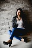 young brunette in leather jacket stock photos