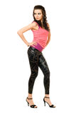 Sexy young brunette in a leggings Royalty Free Stock Photography