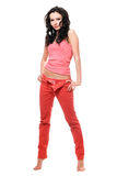 Sexy young brunette in a red jeans Stock Images