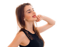 Sexy young brunette with red lips and closed eyes posing and smiling isolated on white background Stock Image