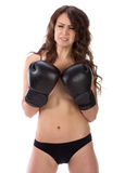 Sexy young brunette woman with black boxing gloves covering brea Royalty Free Stock Photography