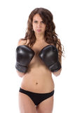 Sexy young brunette woman with black boxing gloves covering brea Royalty Free Stock Photo