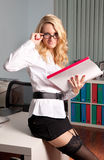 Sexy young business lady in office Royalty Free Stock Photo