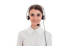 young call center office girl with headphones and microphone looking at the camera and smiling isolated on white Royalty Free Stock Images