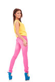 Sexy young casual woman in colorful clothes. Standing on white background Royalty Free Stock Image