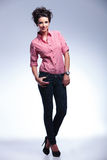 young casual woman standing with her hands in pockets Stock Image