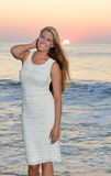 Sexy young Caucasian woman on beach at sunrise Stock Image