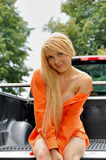 young country woman sitting in back of truck Royalty Free Stock Images