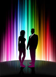 Sexy Young Couple on Abstract Spectrum Background Stock Photo
