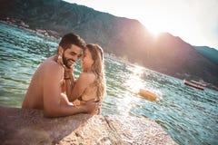 Young couple on the beach having fun royalty free stock photos