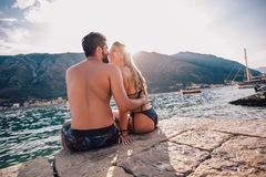 Young couple on the beach having fun stock image