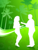 Sexy young couple dancing on palm trees Royalty Free Stock Photo