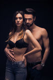 Sexy young couple intimate, looking at camera, bra shirtless jea Royalty Free Stock Image