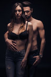 Sexy young couple intimate, looking at camera, bra shirtless jea Stock Photography