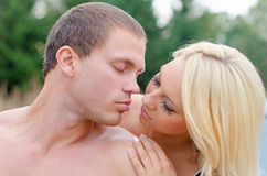 Sexy young couple kissing. Stock Photos
