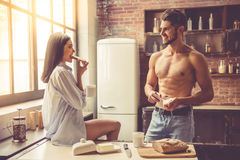 Sexy young couple in kitchen Royalty Free Stock Photos