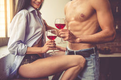 Sexy young couple in kitchen Stock Photos