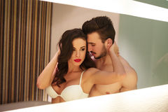 Sexy young couple in mirror at home Royalty Free Stock Photography